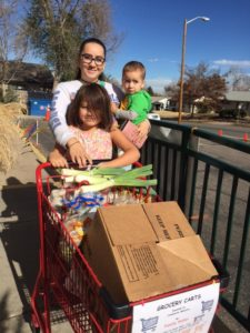 Family with cart of food